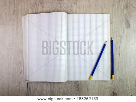 Notepad And Pencil On Wood Table