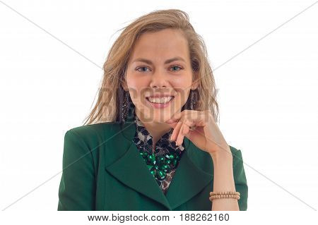 Portrait of a smiling young blond chic who looks into a camera close-up of isolated on white background