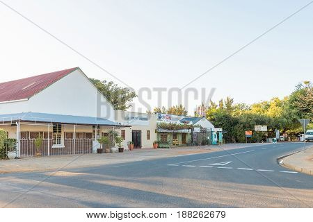 RIEBEECK WEST SOUTH AFRICA - APRIL 2 2017: An early morning street scene with liquor store and supermarket in Riebeeck West a town in the Swartland area of the Western Cape Province