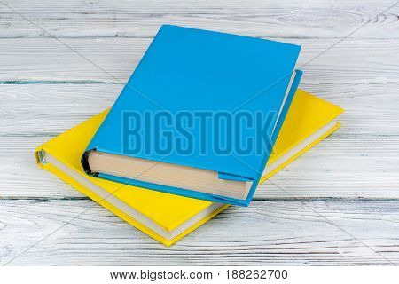 Colorful books on white wooden table. Back to School