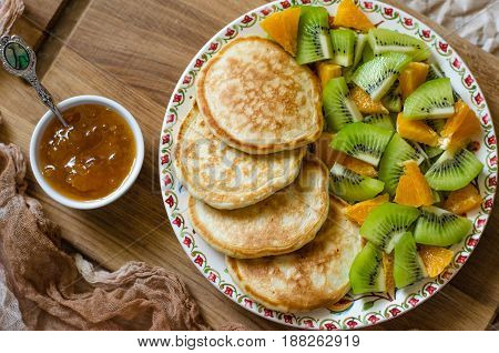 Pancakes With Kiwi Mandarins And Jam For Breakfast
