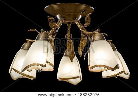 Modern Chandelier for interior decoration of the living room and kitchen. Bronze Chandelier isolated on black background.