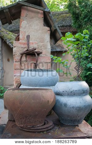 Ancient metal pans on stone kitcken .