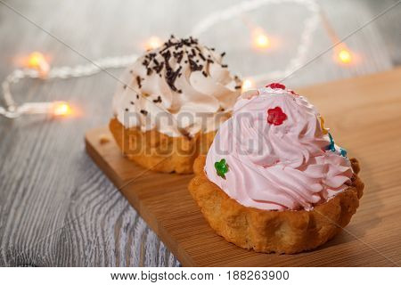 A Small Cake On A Wooden Table.