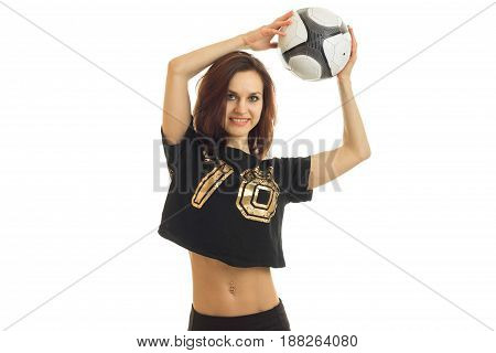 a charming young athlete raised above the head soccer ball isolated on white background