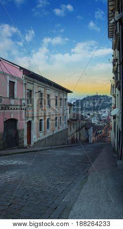 Quito, Pichincha / Ecuador - May 27 2016: View of El Panecillo hill from Garcia Moreno street in the historic center of the city of Quito