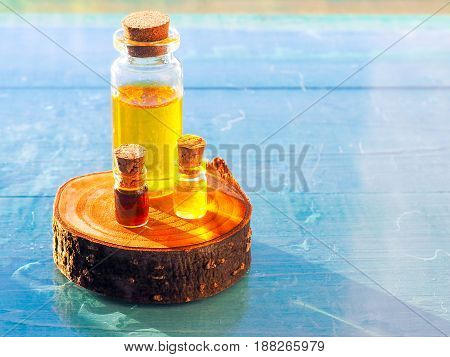 bottle of aroma essential oil or spa or natural fragrance oil with on wooden table spa or alternative meditation aroma
