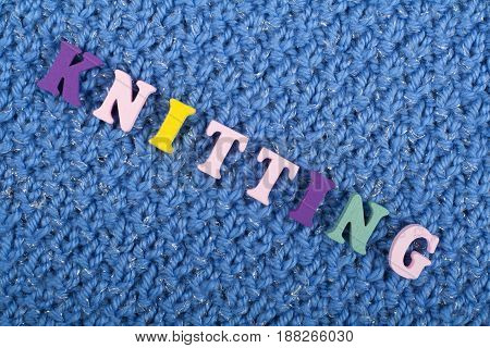 Knitting. Blue Knitted Fabric Texture. Word composed from ABC alphabet letters