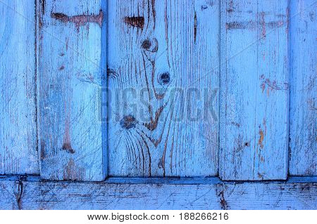Old Solid Wood Slats Rustic Shabby Isolated Background. Painted Peeled Grunge Weathered Isolated Hardwood Surface. Faded Natural Wood Board Panel painted blue.