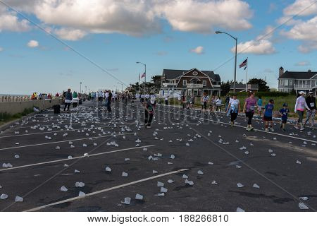 Spring Lake NJ USA -- May 27 2017 A long trail of discarded water cups is on the street as the race begins to wind down. Editorial use only.