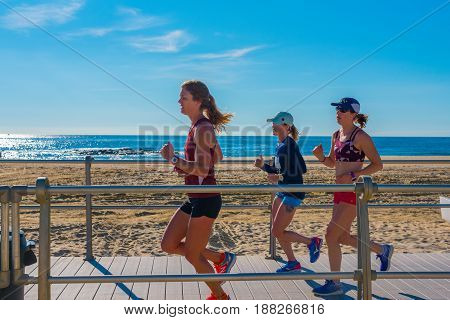 Spring Lake NJ USA -- May 27 2017 Female joggers out for a morning run on the boardwalk in Spring Lake. Editorial Use Only.