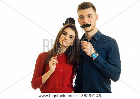 funny couple holding paper Dummies for photo and looking at camera isolated on white background