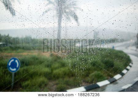 Israel rain view to street through rain-specked window
