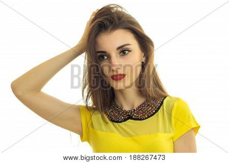 a wonderful young girl with red lipstick looks away and keeps a hand near hair close-up isolated on white background