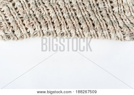 Sweater or scarf fabric texture large knitting. Knitted jersey background with a relief pattern. Braids in knitting . Wool hand- machine, handmade.