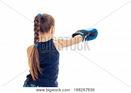 little girl in blue gloves practicing boxing skills isolated on white background