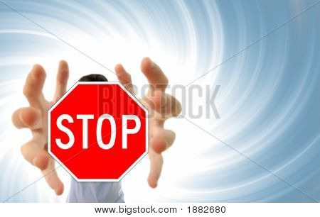 Man Grabing A Stop Sign