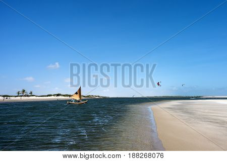Lencois Maranhenses National Park Brazil - July 15 2016: A traditional fishing boat sails along the ocean channel to the tide in Atins