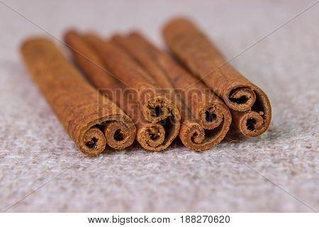 Cinnamon Sticks On A Gray Brown Linen Background