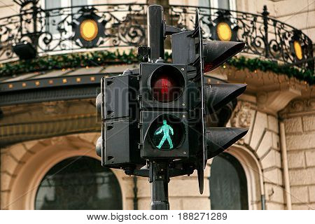 Modern traffic light in Amsterdam. The green light is on. It is allowed to cross the road.