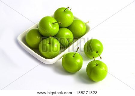Sour plum pictures on white ground, wonderful sour plums, green plums pictures from the first fruits in summer