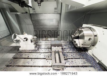 Working area of modern double-spindle CNC metalworking machine.