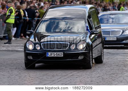 HELSINKI, FINLAND - MAY 25: The state funeral and cortege of the former President of the Republic of Finland Mauno Koivisto on Mannerheimintie May 25, 2017 in Helsinki, Finland.