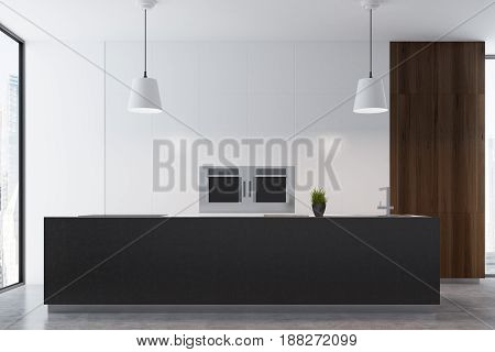 Close up of a studio kitchen interior with a black countertop a sink a stove and a dark wooden decoration panel near a tall window. 3d rendering