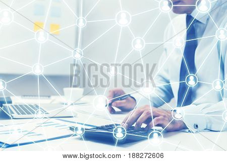 Close up of unrecognisable businessman s hands lying on his table with a smartphone a laptop and blue graphs attached to a clipboard. Toned image double exposure