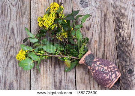 Flower vase overturned on table. Studio Photo