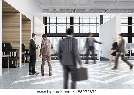 People walking near office cubicles in an office with white and wooden walls. There are blank vertical pictures in each of them a desk with a computer a chair and shelves. Side view. 3d rendering