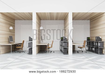 Office cubicles in an office with white and wooden walls and diamond floor pattern. There are blank pictures a desk with a computer a chair and shelves. Front view. 3d rendering mock up