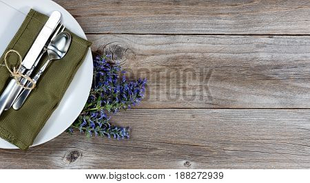 Vintage table setting with fresh flowers on rustic wood