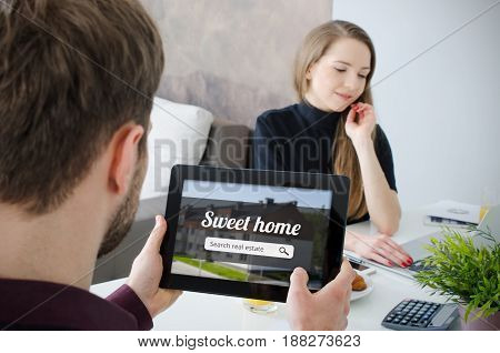 Young Couple Looking On The Internet Your Own Home