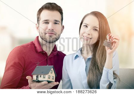 Young Couple Enjoys Getting The Keys To Own Home