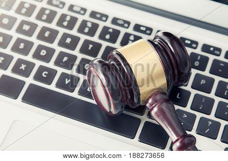 Wooden Gavel On Laptop Keyboard