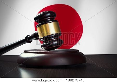 Wooden gavel with Japanese flag in background. Justice and law symbol