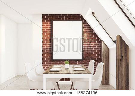 View of an attic kitchen with brick walls a long wooden table and a framed vertical poster. 3d rendering mock up