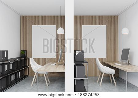 Close up of office cubicles in an office with white and wooden walls. There are blank vertical pictures in each of them a desk with a computer a chair and shelves. 3d rendering mock up