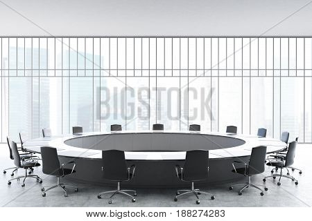 Meeting room interior with a large black round table office chairs standing around it and a window with a magnificent view. 3d rendering mock up