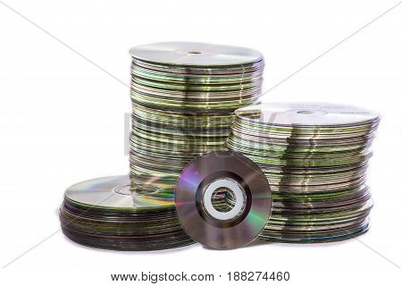 Heap of old used cd and mini disks. Isolated over white background