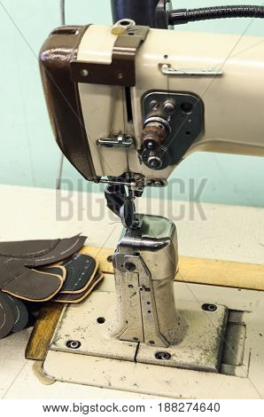 Sewing machine for sewing shoes. Footwear production.