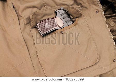 Pistol In The Jacket Pocket. The Policeman's Gun.