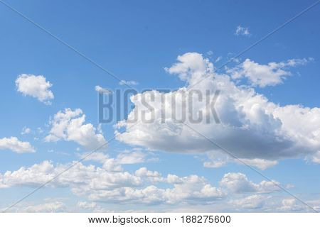 White clouds on the blue clear sky. It can be used as background.