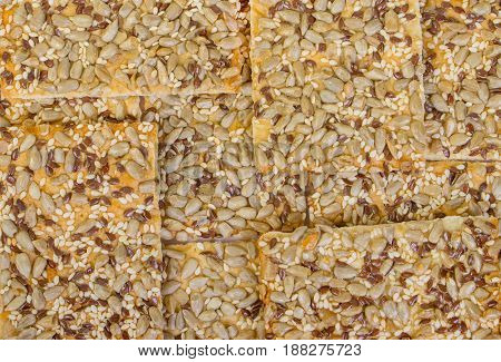 Rows of various shortbread and oat cookies cereals background.
