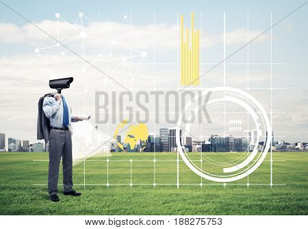 Elegant businessman outdoors with camera instead of head and media interface on screen