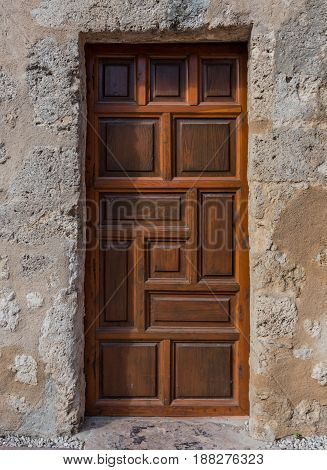 Solid Wood Door In Mission Wall made of gray stucco
