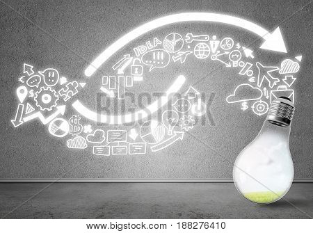 Glass glowing light bulb and business sketched ideas on wall