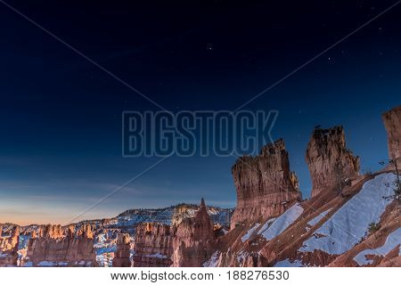 Stars Over Hoodoos with sun beginning to rise