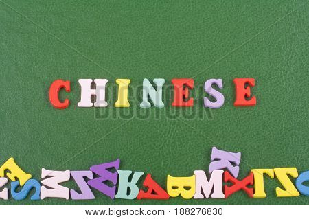 CHINESE word on green background composed from colorful abc alphabet block wooden letters, copy space for ad text. Learning english concept